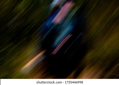 Psychedelic black pod with multicolor light streaks / abstract hiker with colourful backpack, moving through yellow green and earth brown natural landscape - abstract motion blur background / texture
