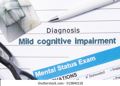 Psychiatric Diagnosis Mild Cognitive Impairment. Medical book or form with the name of diagnosis Mild Cognitive Impairment is on table of doctor surrounded by questionnaire to determine mental state