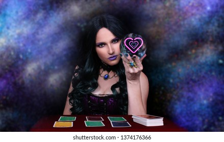 Psychic with black and green hair  Crystal Ball. and tarot cards