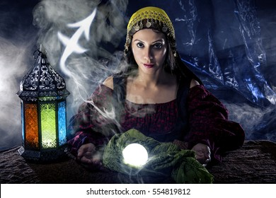 Psychic or fortune teller with crystal ball and horoscope zodiac sign of Sagittarius, birthdays of November to December. The image depicts astrology in a mystical, esoteric or magical theme composite.