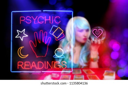 Psychic Readings Sign With Tarot Card Reader in background
