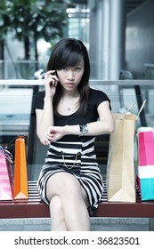 Psycho Asian Female Shopper Serious and Waiting