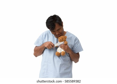 Psycho patient was holding a knife pointing at victim's throat bear doll