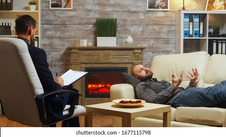 Psychoanalyst giving consultation to young man about his relationship problems.