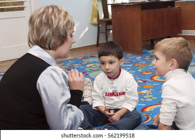 Psychologist conducts classes with a boys in Sunday school