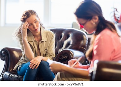 Psychologist having session with her patient in office