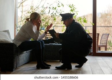 Psychologist of the police talking to a victim after a burglary with theft