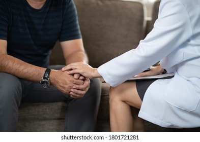 psychologist or psychiatris hold hands psychosis patient to have depression and stress for give encouragement and psychotherapy.