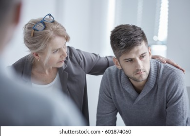 Psychologist supporting young man suffering from depression
