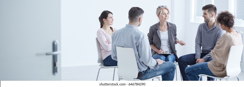 Psychologist and young people with schizophrenia during group therapy