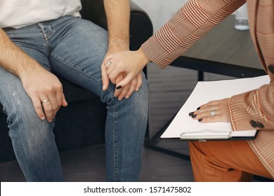 In the psychologist's office. Man and woman talking