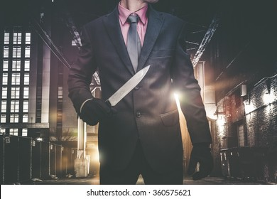 Psychopathic Downtown Murderer Walking Through the Alley with Huge Knife. Wearing Elegant Suit and Tie. Urban Crime Concept.