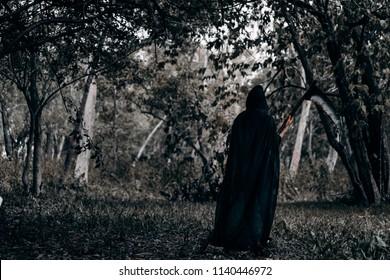 Psychopomps with scythe horor halloween at dark forest, demon or devil ghost dangerous kill soul concept.