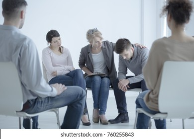 Psychotherapist supporting a man who lost his wife. Support group meeting for people in mourning