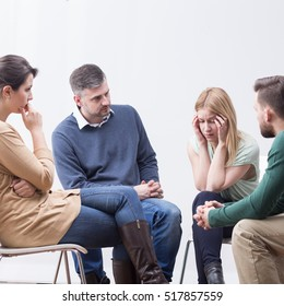 Psychotherapy group supporting worried young friend with problem