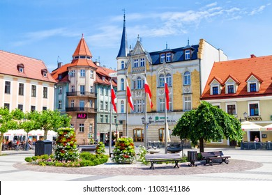 PSZCZYNA, POLAND - MAY 31, 2018: Scenery of main market square in historical european city center with colorful old buildings and clear blue sky in warm sunny spring day.