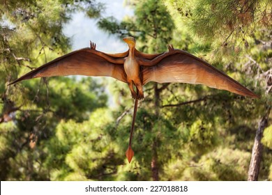 Pterodactyl - prehistoric era wing dinosaur flying at forest