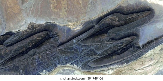 Pterosaur stone giant fossil, flying dinosaur from the air, abstract photography of the deserts of Africa from the air, bird's eye view, abstract expressionism, contemporary art, optical illusions,