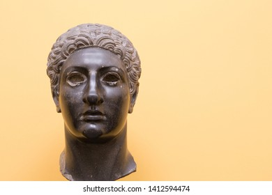 Ptolemy III Euergetes, king of Egypt. Slightly damaged antique sculpture, dark against a light background with copy space.