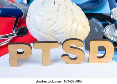 PTSD Medical abbreviation or acronym of post traumatic stress syndrome, mental disorder caused by traumatic events. Word PTSD near figure of human brain, MRI test result, stethoscope and neurological