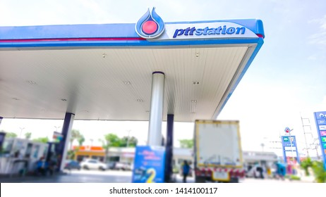 PTT oil station, Sirisothon Road, Na Mueang, Mueang Chachoengsao, 1 June 2019 Front view of the pump which overlooks the PTT station logo. The logo is above the oil dispenser with  Blurred lens.