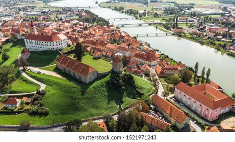 Ptuj Grad in Slovenia, Historic Old Town and Castle. Aerial Drone View.