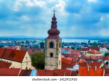 PTUJ, SLOVENIA, April 30 2017: Aerial view over old part of town with church tower and red houses roofs in Ptuj, Slovenia.