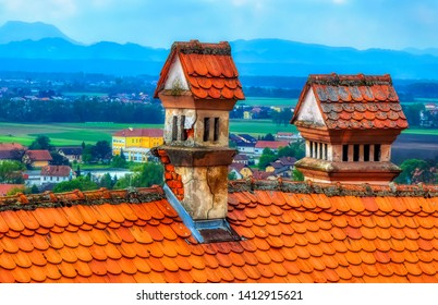 PTUJ, SLOVENIA, April 30 2017: Old chimney at red roof of old house in Ptuj, Slovenia.