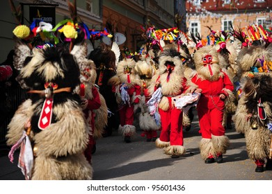 PTUJ, SLOVENIA - FEBRUARY 19: Kurent is a traditional carnival mask with cow bells, dressed in fur and special headgear. They banish away the winter. Ptuj, Slovenia February 19, 2012.