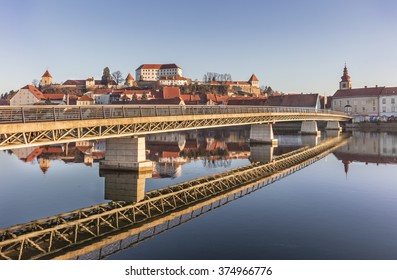 PTUJ, SLOVENIA - FEBRUARY 6, 2016:Modern bridge structure and its reflection in old town Ptuj