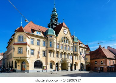 Ptuj, Slovenia - March 17, 2019: Street in Ptuj old city with Town Hall in Slovenia. Architecture in Slovenija. Travel