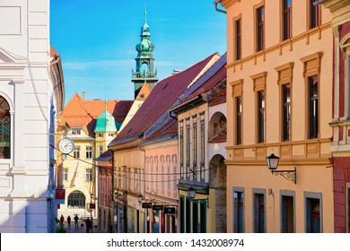 Ptuj, Slovenia - March 17, 2019: Street at Ptuj old city with Town Hall in Slovenia. Architecture in Slovenija. Travel
