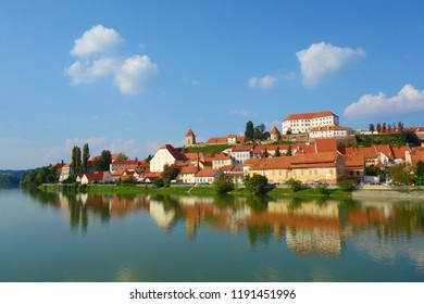 Ptuj, Slovenia, is the oldest city in Slovenia with a castle overlooking the old town from a hill and the Drava river beneath with nice reflections in the water