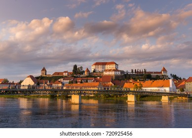 Ptuj, Slovenia, panoramic shot of oldest city in Slovenia with a castle overlooking the old town from a hill and the Drava river beneath