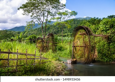 Pu Luong water wheel, inventive traditional system to irrigate the rice fields with bamboo pipelines.. Vietnam rural landscape in the Mai Chau area.