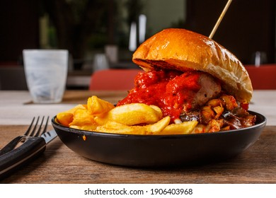 Pub sandwich with spicy Apulian bombette, fried eggplant and smoked provolone