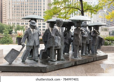 Public art The Gentlemen by Taiwanese sculptor Ju Ming at 330 N. Wabash Ave on Chicago River's North bank, Chicago, Illinois, USA, October 6, 2016
