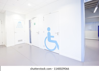 In an public building are womans ,man, invalid toilets doors and an shower door