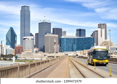 Public Bus on Elevated Highway with Downtown Dallas in the Background - Dallas, Texas, USA