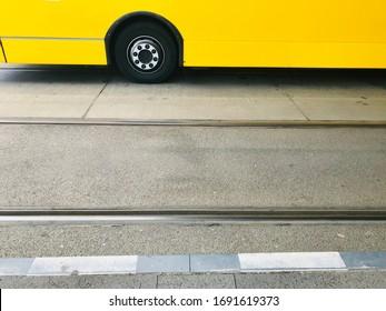 Public bus wheels on a city streets in Berlin unique photo