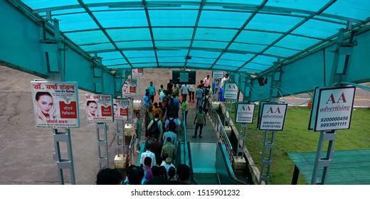 public crowd on moving exelator at railway station district jabalpur Madhya Pradesh in India shot captured on sep 2019