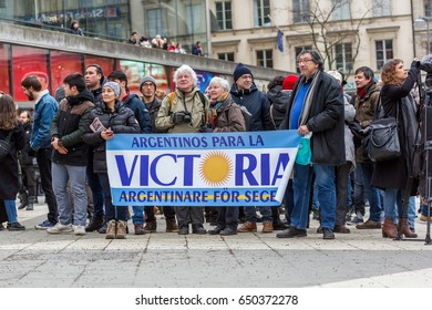 Public demonstration. Stockholm, Sweden - January 21, 2017: Low angle view of a group of elderly and young people holding a banner at a public square protesting. Buildings in the background.
