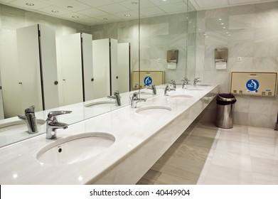 public bathroom mirror. Perfect Bathroom Public Empty Restroom With Washstands Baby Changer And Toillets In Mirror On Bathroom Mirror