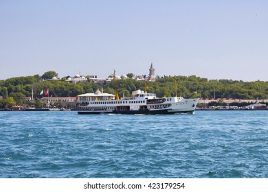 Public ferry passes in front of Topkapi Palace in Istanbul