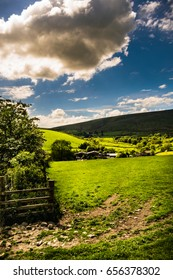 Public footpath on the farm near to Pendle Hill, Springtime in Forest of Bowland, Lancashire, England UK