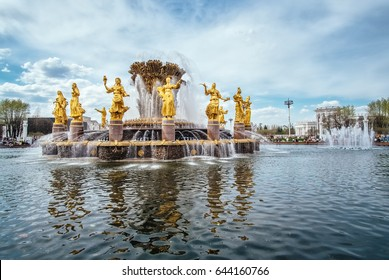 Public fountain of friendship of the people view at VDNH city park exhibition, blue sky and clouds in Moscow, Russia outdoor landscape. Beautiful architecture of golden fountain in Moscow city, Russia