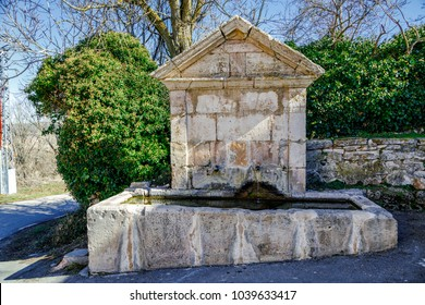 Public fountain of Palazuelos stone in the province of Guadalajara, Spain