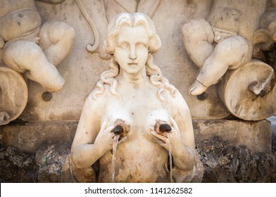 Public fountain of St. Andrew in Amalfi town, Italy, representing a woman holding her breasts while water pours from her nipples