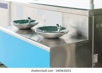 Public free drinking fountain tap made of stainless stell in modern design