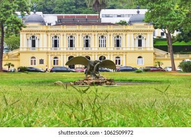 Public garden with yellow palace in the background in the Imperial City of Petropolis